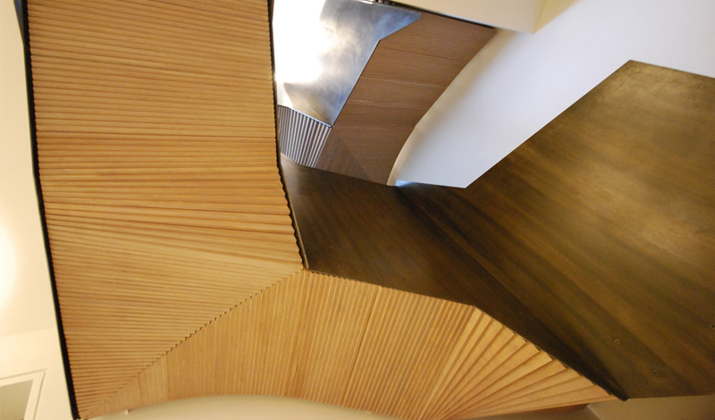 """Monolithic Stepped plywood soffit staircase """