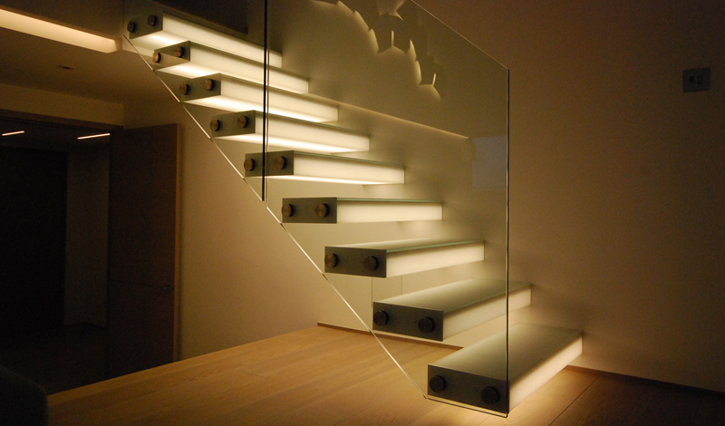 cantilevered glass box treads concealed light private